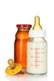 pacifier сока бутылки младенца Стоковые Изображения