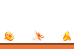 Pacifier Background. Orange and White Pacifier Background Stock Image