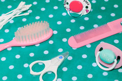 Pacifier and brushes for newborn babies Stock Images