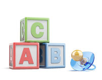 Pacifier and buzzword blocks Royalty Free Stock Images