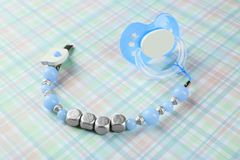Pacifier clip with place for baby name and dummy Stock Images