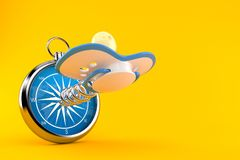 Pacifier with compass. Isolated on orange background. 3d illustration Royalty Free Stock Images