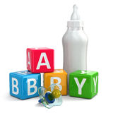 Pacifier, Milk in bottle and buzzword blocks with word baby. Stock Photo