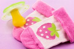 Pacifier and socks Stock Photography
