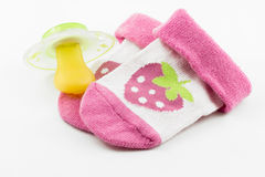 Pacifier and socks Stock Photo