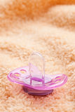 The pacifier on soft background Royalty Free Stock Photo