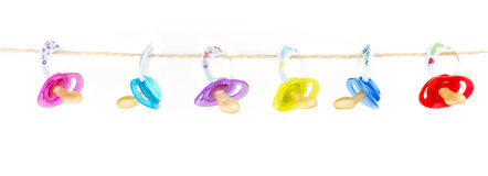 Pacifiers hanging Royalty Free Stock Photo