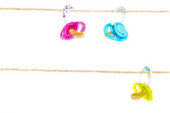 Pacifiers hanging Royalty Free Stock Photos