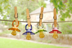 Pacifiers in line Royalty Free Stock Images