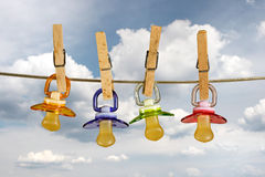 Pacifiers in line Royalty Free Stock Photography