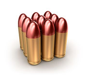 Pack of ammo catridges with bullets over white. Stock Photos