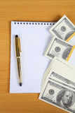 Pack of banknotes and notebook Royalty Free Stock Photography