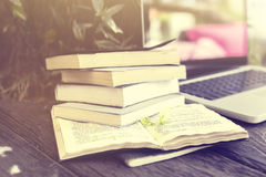 Pack of books and laptop Stock Images