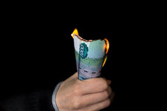 Pack of burning rubles in person's hand horizontal Royalty Free Stock Photography