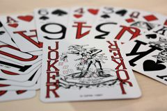 Pack of cards close up. Selection of cards with joker as main focus Stock Photo
