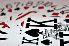 Pack of cards close up. Selection of cards with king of spades as main focus Stock Photos