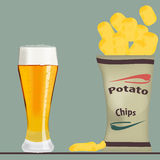 Pack of chips and glass of beer Stock Photo