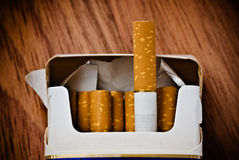 Pack of cigarettes. On table Royalty Free Stock Photos