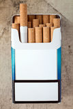 Pack of cigarettes with cigarettes sticking out Stock Photography