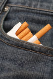 Pack of cigarettes in pocket of jeans Royalty Free Stock Image