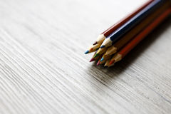 Pack of color pencils or pastel on wooden floor Stock Image