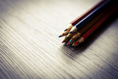 Pack of color pencils or pastel on wooden floor Stock Images