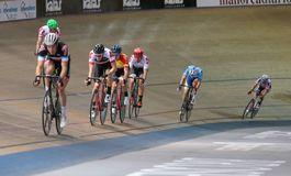 Sixday cycling series finals in palma velodrome wide. The pack of Cyclists ride during their final resistance race at the Sixday cycling event finals in stock photo