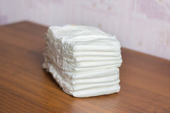 Pack of diapers. The pack of diapers lies on a table Royalty Free Stock Image