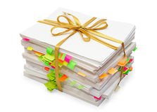 Pack of documents tied up by a gold ribbon. Pack of documents with bookmarks tied up by a gold ribbon Royalty Free Stock Image