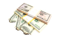 Pack of dollars and burned dollars Royalty Free Stock Images