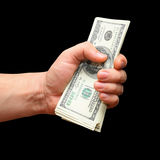 Pack of dollars in a fist. On black background Royalty Free Stock Images