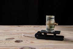 Pack of dollars on a sled royalty free stock image