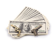 Pack of dollars and weapon Stock Photography
