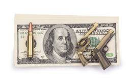 Pack of dollars and weapon Stock Images