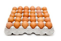 Pack 30 eggs. On a white background royalty free stock images