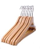 Pack of eight wooden clothes hangers Stock Photography