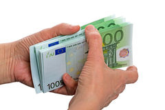 Pack of 100 euro banknotes. In the hands of women. Isolated on white background Royalty Free Stock Photography