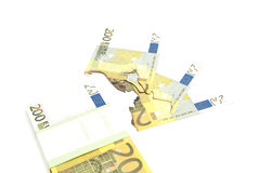 Pack of euros and burned bills on white Stock Photo