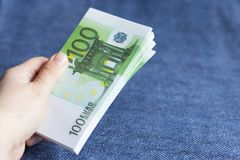 Pack of euros in hand,. On a blue background Royalty Free Stock Photography