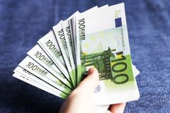 Pack of euros in hand,. On a blue background royalty free stock photos
