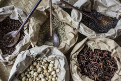 Pack of famous spices in asia. A pack of famous spices in asia, clove, anise, white pepper, black pepper and cardamom Stock Photo