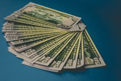 Pack of fifty dollars banknotes isolated on blue background.  royalty free stock photos