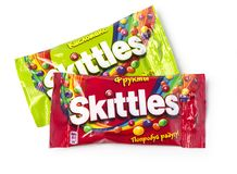 Pack of Fruit Skittles. Chisinau, Moldova, April 21, 2018: Pack of Fruit Skittles over a plain white background, with clipping path. The Skittles sweets brand is Royalty Free Stock Photo