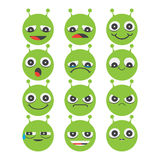 Pack of green alien smiley emoji faces Stock Images