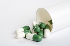 Pack of green capsules isolated on white Royalty Free Stock Images