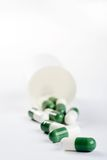 Pack of green capsules isolated on white Stock Photography