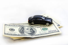 Pack of hundred-dollar notes and children's toy car. Pack of hundred-dollar notes and black children's toy car Royalty Free Stock Images