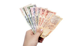 Pack of Indian currency notes held in hand Stock Photo