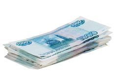 Pack of the money on white background. Pack of the bills on one hundred roubles on white background Royalty Free Stock Images