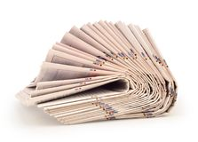 A pack of newspapers isolated. A pack of newspapers on a white background Royalty Free Stock Images